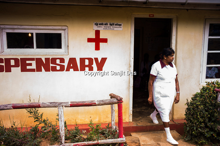 A nurse walks out of the local dispensary in Eskdale Tea Estate in Nuwareliya in Central Sri Lanka.  Photo: Sanjit Das/Panos