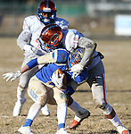 Bishop Gorman's Palaie Gaoteote tackles Reed's Jorden Carter in an NIAA Division I playoff game at Reed High School in Sparks, Nev., on Saturday, Nov. 28, 2015. Bishop Gorman won 41-13. (Cathleen Allison/Las Vegas Review-Journal)