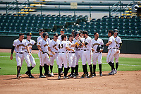 Bradenton Marauders Jesse Medrano (3) is congratulated by teammates, including Dylan Busby (28), Michael Gretler (10), Daniel Amaral (43), John Bormann (15), Lucas Tancas (27), Chris Sharpe (18), and others, after a walk off bunt base hit during a Florida State League game against the Charlotte Stone Crabs on April 10, 2019 at LECOM Park in Bradenton, Florida.  Bradenton defeated Charlotte 2-1.  (Mike Janes/Four Seam Images)