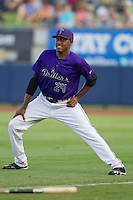 Tulsa Drillers center fielder Delta Cleary Jr. (24) warms up in the outfield prior to the Texas League game against the Frisco RoughRiders at ONEOK field on August 15, 2014 in Tulsa, Oklahoma  The RoughRiders defeated the Drillers 8-2.  (William Purnell/Four Seam Images)