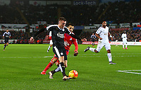 Jamie Vardy of Leicester City rounds Lukasz Fabianski of Swansea City but misses an open goal from a tight angle during the Barclays Premier League match between Swansea City and Leicester City played at The Liberty Stadium on 5th December 2015
