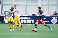 FOXBOROUGH, MA - MAY 16: Carles Gil #22 of New England Revolution passes the ball from the midfield during a game between Columbus SC and New England Revolution at Gillette Stadium on May 16, 2021 in Foxborough, Massachusetts.