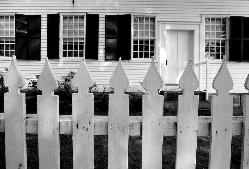 White fence frames the meetinghouse at the Canterbury Shaker Village, New Hampshire. Photogaph by Peter E. Randall