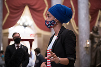United States Representative Ilhan Omar (Democrat of Minnesota) talks with reporters in Statuary Hall as the House votes on H. Res. 24, Impeaching Donald John Trump, President of the United States, for high crimes and misdemeanors, at the U.S. Capitol in Washington, DC, Wednesday, January 13, 2021. Credit: Rod Lamkey / CNP /MediaPunch
