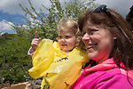 Sarah's mom, Debbie Hyatt, holds Katelyn at the Cleveland Zoo as they watch giraffes grazing in a field.