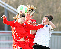 Rebecca Moros #19 and Allie Long #9 of the Washington Freedom go up for a header against Carly Pezetes #15 of the Philadelphia Independence during a WPS pre season match at the Maryland Soccerplex on March 27 2010 in Boyds, maryland