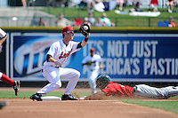 Great Lakes Loons shortstop Brandon Trinkwon (10) takes a throw as Mallex Smith (3) steals second during a game against the Fort Wayne TinCaps on August 18, 2013 at Dow Diamond in Midland, Michigan.  Fort Wayne defeated Great Lakes 4-3.  (Mike Janes/Four Seam Images)