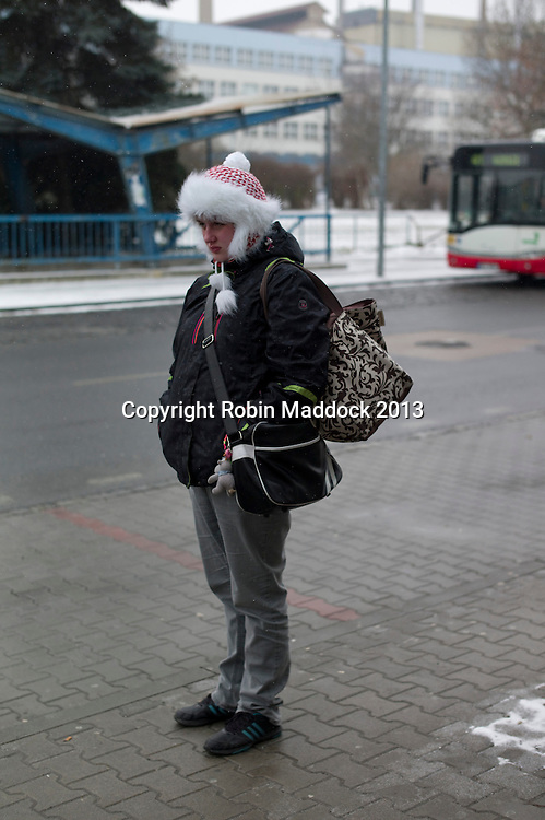 girl waiting for a bus in pilsen