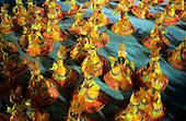 Rio de Janeiro, Brazil. Carnival; vibrant samba dancing baianas, in yellow and orange. Sapucai, sambodromo.