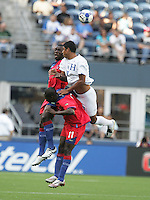 Melvin Valladares (18) jumps over Fabrice Noel (11) for the header. Honduras defeated Haiti 1-0 during the First Round of the 2009 CONCACAF Gold Cup at Qwest Field in Seattle, Washington on July 4, 2009.