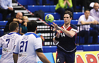 02 NOV 2011 - LONDON, GBR - Britain's Steve Larsson (right in blue and red) passes during the Men's 2013 World Handball Championship qualification match against Israel at the National Sports Centre at Crystal Palace (PHOTO (C) NIGEL FARROW)