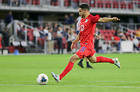 WASHINGTON, D.C. - OCTOBER 11: Cristian Roldan #15 of the United States warming up during their Nations League match versus Cuba at Audi Field, on October 11, 2019 in Washington D.C.