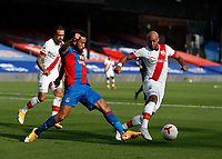 12th September 2020; Selhurst Park, London, England; English Premier League Football, Crystal Palace versus Southampton; Nathan Redmond of Southampton challenges Andros Townsend of Crystal Palace