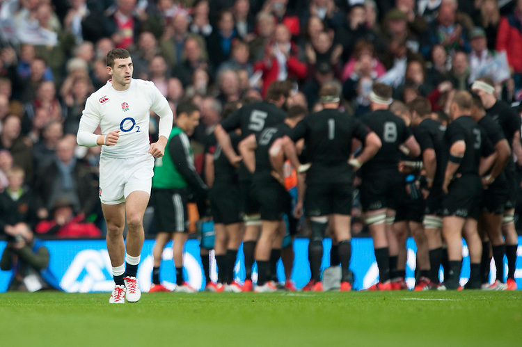 Jonny May of England trots back after scoring the opening try during the QBE International match between England and New Zealand at Twickenham Stadium on Saturday 8th November 2014 (Photo by Rob Munro)