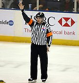 February 24th 2008:  Referee Jamie Koharski, son of legendary NHL official Don Koharski, makes a call in a game between the Houston Aeros and Rochester Amerks at Blue Cross Arena at the War Memorial in Rochester, NY.  The Aeros defeated the Amerks 4-0.   Photo copyright Mike Janes Photography 2008