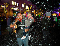 Charlotte Christmas Events - Photography of the Phillips Place Winter Wonderland Christmas event in Charlotte, North Carolina.<br /> <br /> Children playing in the fake snow being blown out of machines at a Charlotte Christmas holiday event.<br /> <br /> Charlotte Photographer - PatrickSchneiderPhoto.com