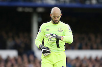 Tim Howard adjusts his gloves during the Barclays Premier League match between Everton and Swansea City played at Goodison Park, Liverpool