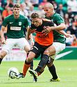 Hibs' Farid el Alagui and Dundee Utd's John Rankin challenge for the ball.