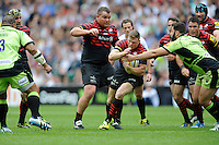 Chris Ashton of Saracens is tackled by Alex Corbisiero of Northampton Saints as he makes a break  during the Aviva Premiership Final between Saracens and Northampton Saints at Twickenham Stadium on Saturday 31st May 2014 (Photo by Rob Munro)