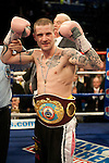 GLASGOW, SCOTLAND - MARCH 10: Ricky Burns of Scotland defeats Paulus Moses of Namibia to retain the WBO world lightweight title at the Braehead Arena on March 10, 2012 in Glasgow, Scotland. (Photo by Rob Casey/Getty Images)