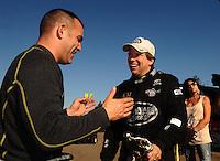 Mar. 13, 2011; Gainesville, FL, USA; NHRA top fuel dragster driver Tony Schumacher (left) congratulates Del Worsham after winning the Gatornationals at Gainesville Raceway. Mandatory Credit: Mark J. Rebilas-