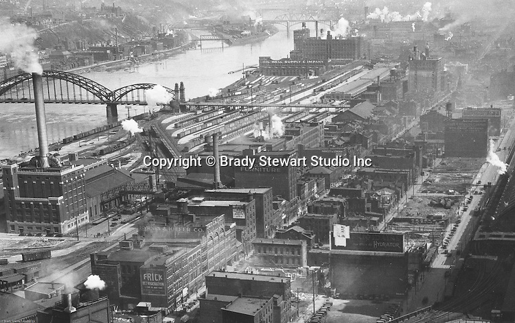 Pittsburgh PA:  View of the Strip District Railroad yards, 16th Street Bridge, and Strip District businesses taken from the new Kopper's Building. A few notable companies in the strip at that time were; Byrnes & Kiefer Company, Frick Refrigeration, Gloekler Refrigeration Company, Hardesty and Stineman Bankers Supplies, James W Houston Company, Marietta Chair Company, and Oil Well Supply Company.
