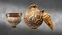 Minoan pottery with stylised octopus decorations, 1500-1400 BC, Heraklion Archaeological Museum, grey background.<br />   <br /> From Left to right<br /> 1- Krater Episkopi Lerapetra 1370-1250 BC, <br /> 2- flask with Marine style stylised octopus design,   Palaikastro,  1500-1450 BC; <br /> 3- far right  conical rhython with Marine style stylised octopus design,   Palaikastro 1500-1450 BC;