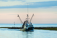 Commercial quahog fishing boat returns with the days catch, Rock Harbor, Orleans, Cape Cod, Massachusetts, USA