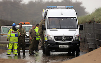 Pictured: Bomb experts arrive at Cefn Sidan beach, near Pembrey west Wales, UK. Saturday 21 May 2016<br />