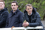 © Joel Goodman - 07973 332324 . 25/04/2015 . Salford , UK . Gary and Phil Neville watch from the sidelines . Evostick League champions , Salford FC , play Osset Town , in Salford . Photo credit : Joel Goodman