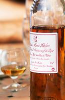 A snifter glass and A bottle of Chateau Mont Redon Vieux Marc de Chateauneuf, eau de vie de marc des cotes du Rhone. Spirit made from chateauneuf wine press residues. The restaurant Le Verger de Papes Chateauneuf-du-Pape Vaucluse, Provence, France, Europe