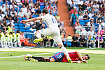 Real Madrid's player Nacho Fernandez and Osasuna's player Roberto Torres during a match of La Liga Santander at Santiago Bernabeu Stadium in Madrid. September 10, Spain. 2016. (ALTERPHOTOS/BorjaB.Hojas)