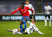 20th April 2021; Liberty Stadium, Swansea, Glamorgan, Wales; English Football League Championship Football, Swansea City versus Queens Park Rangers; Osman Kakay of Queens Park Rangers is tackled by Jake Bidwell of Swansea City