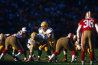 SAN FRANCISCO, CA: Quarterback Brett Favre of the Green Bay Packers stands at the line of scrimmage during the NFC playoff game against the San Francisco 49ers at Candlestick Park in San Francisco, California on January 6, 1996. (Photo by Brad Mangin)