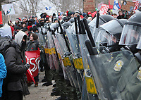 Riot police stand in line, blocking access to the legislature to students demonstrating against tuition hikes Thursday, March 1, 2012 at the legislature in Quebec City.<br /> <br /> PHOTO :  Francis Vachon - Agence Quebec Presse