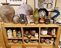 BNPS.co.uk (01202 558833)<br /> Pic: AdamPartridgeAuctioneers/BNPS<br /> <br /> Pictured: Pots squeezed onto shelving<br /> <br /> A huge collection of pottery and ceramics found stacked inside the suburban home of an elderly couple has sold for almost £200,000.<br /> <br /> Leonard and Alison Shurz filled every room of their three bed house with ceramic pieces they had gathered from all over the world.<br /> <br /> The Aladdin's Cave of pots, bowls, plates, vases and jugs was found by a stunned auctioneer who had the daunting task of cataloguing it all.