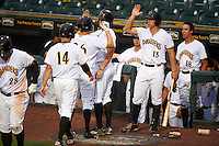 Bradenton Marauders Jordan Luplow (26) high fives Michael Suchy (13) after hitting a home run during a game against the Palm Beach Cardinals on August 9, 2016 at McKechnie Field in Bradenton, Florida.  Palm Beach defeated Bradenton 8-7.  Kevin Kramer (14) and Cole Tucker (18) are also shown.  (Mike Janes/Four Seam Images)