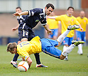 ACCIES ANDY RYAN IS FOULED BY ROVERS' LAURIE ELLIS
