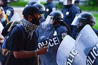 Washington, DC - June 1, 2020: A man engages DC police a few blocks from the White House in Washington, DC  June 1, 2020, in the wake of the death of George Floyd by a Minnesota police officer.  (Photo by Don Baxter/Media Images International)