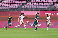 KASHIMA, JAPAN - JULY 27: Christen Press #11 of the USWNT dribbles during a game between Australia and USWNT at Ibaraki Kashima Stadium on July 27, 2021 in Kashima, Japan.