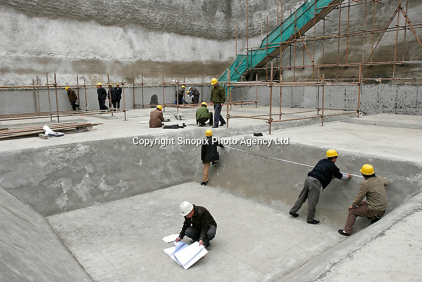 Surveyors do the measurements at a construction site in Beijing, China. .
