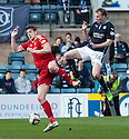 Aberdeen's Ash Taylor and Dundee's David Clarkson challenge for the ball.