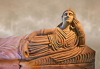 Etruscan Terracotta sarcophagus lid with a female figure reclining, first half of 2nd century BC, inv 15428, The Vatican Museums Rome, Art Background. For use in non editorial advertising apply to the Vatican Museums for a license.