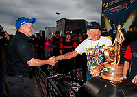 Sep 27, 2020; Gainesville, Florida, USA; NHRA former top fuel dragster driver Don Garlits (right) greets crew chief Paul Smith during the Gatornationals at Gainesville Raceway. Mandatory Credit: Mark J. Rebilas-USA TODAY Sports