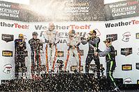 #15 Multimatic Motorsports, Ford Mustang GT4, GS: Scott Maxwell, Ty Majeski, #46 Team TGM, Mercedes-AMG, GS: Hugh Plumb, Owen Trinkler, #39 Carbahn Motorsports, Audi R8, GS: Jeff Westphal, Tyler McQuarrie, podium, champagne