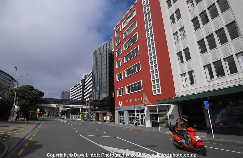 A scooter rider passes the corner of Lower Cuba Street and Wakefield St at 1.20pm on Thursday. Wellington CBD during quarantine lockdown for COVID19 pandemic in Wellington, New Zealand on Thursday, 2 April 2020. Photo: Dave Lintott / lintottphoto.co.nz
