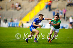 Killian Falvey of Annascaul in possession as Sean Seosamh Ó'hEosa of Castlegregory attempts to tackle for possession in the 2020 Junior football championship final