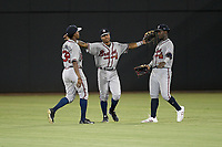 Outfielders, from left, Jeremy Fernandez (32), Justin Dean (5) and Michael Harris (2) of the Rome Braves celebrate after a game against the Columbia Fireflies on Saturday, August 17, 2019, at Segra Park in Columbia, South Carolina. Rome won, 4-0. (Tom Priddy/Four Seam Images)