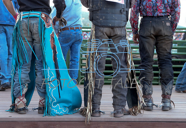 Cowboys listen to the grand entrance ceremony at the Smackdown Tour Bull Riding event at Fuji Park in Carson City, Nev., on Saturday, June 7, 2014.<br /> Photo by Cathleen Allison