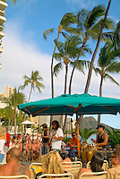Local musician Kapono playing outside at Duke's Waikiki Beach.